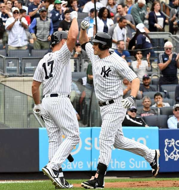 Chase Headley is congratulated at home by Matt