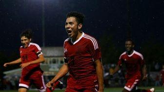Oscar Hernandez of Amityville celebrates the goal against