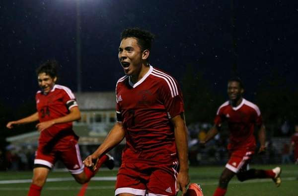Oscar Hernandez of Amityville celebrates the goal against Chaminade