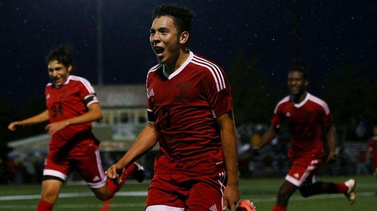 Oscar Hernandez of Amityville celebrates the goal againstChaminade