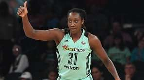 Liberty center Tina Charles reacts against the Phoenix
