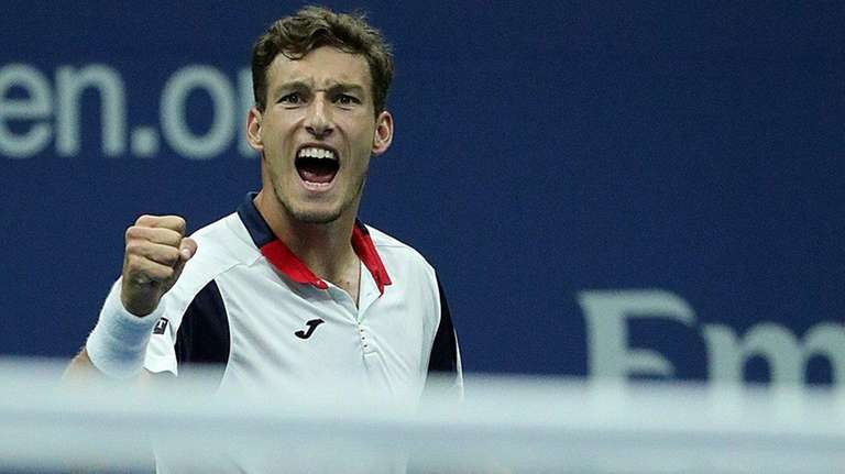 Pablo Carreno Busta reacts after winning a tiebreaker