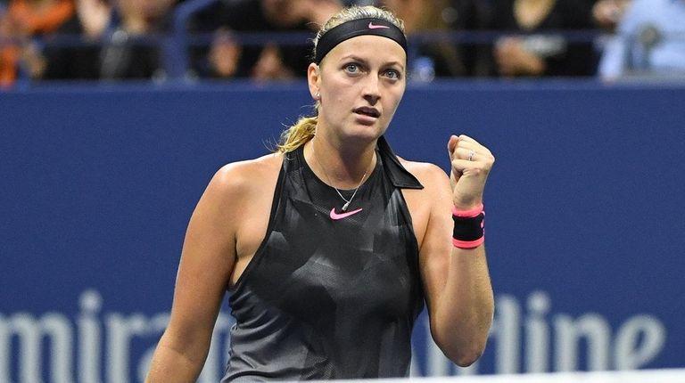 Petra Kvitova reacts against Garbi?e Muguruza in a