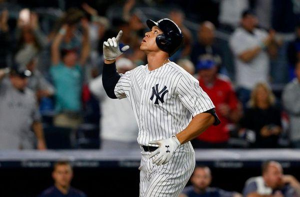 Aaron Judgeof the Yankees celebrates hishome run against