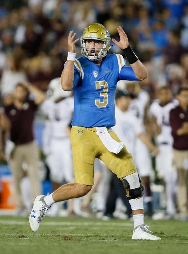 UCLA quarterback Josh Rosen gestures as if he