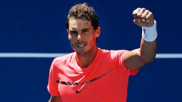 Rafael Nadal waves to fans after beating Alexandr