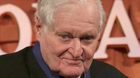 John Ashbery poses for photographs after being presented