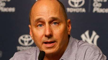 Brian Cashman  speaks to the media at Yankee