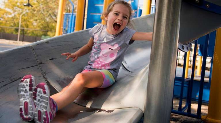 Olivia Andrews-Sales, 5, of Amityville, plays at Bethpage