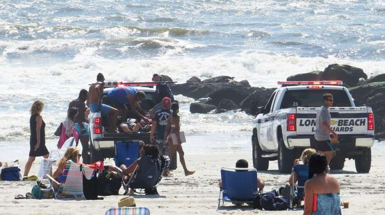 The Long Beach lifeguards respond to a report
