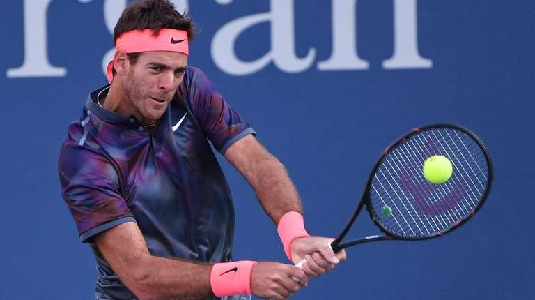 Juan Martin del Potro returns a shot to