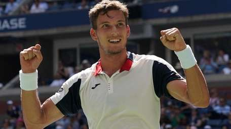 Pablo Carreno Busta celebrates match point against Diego