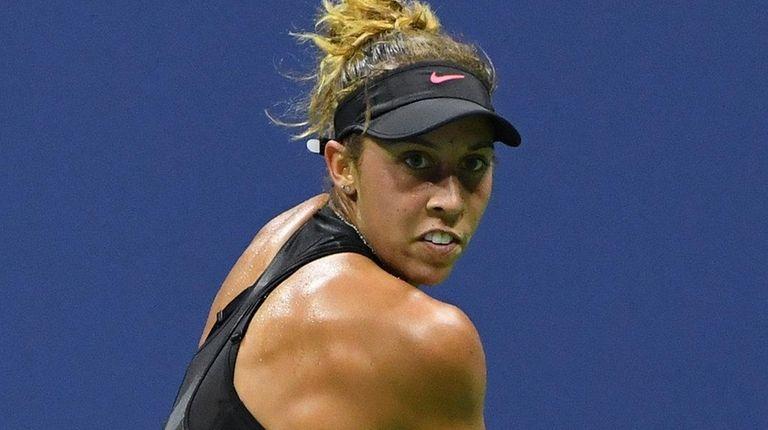 Madison Keys returns a shot to Elina Svitolina