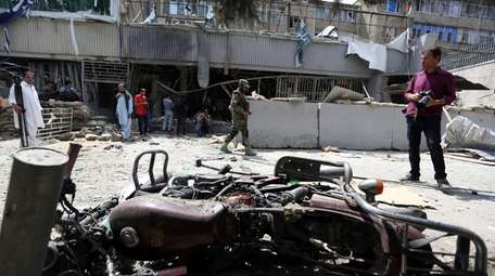 Debris litters the front of Kabul Bank after