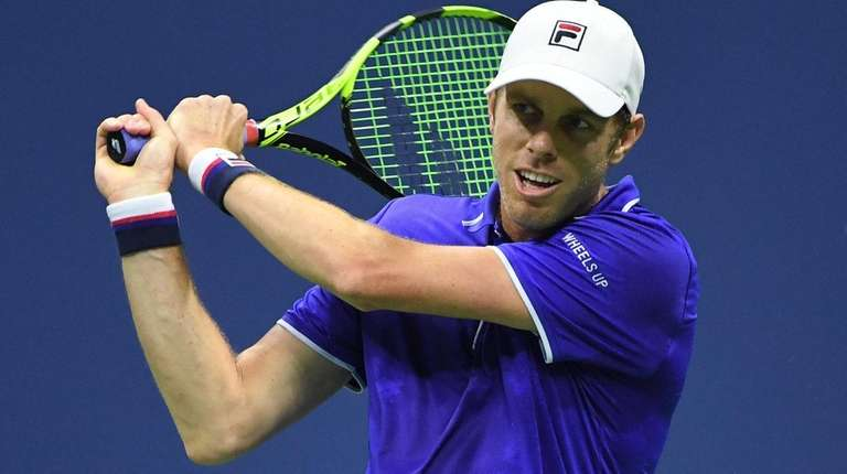Sam Querrey returns a shot to Kevin Anderson