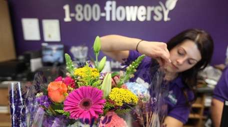 Store manager Lauren Ceglio wraps a floral arrangement