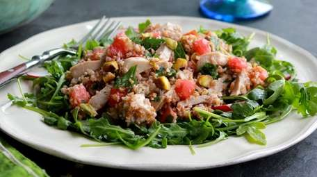 A salad made with bulgur wheat, pistachios, tomatoes,