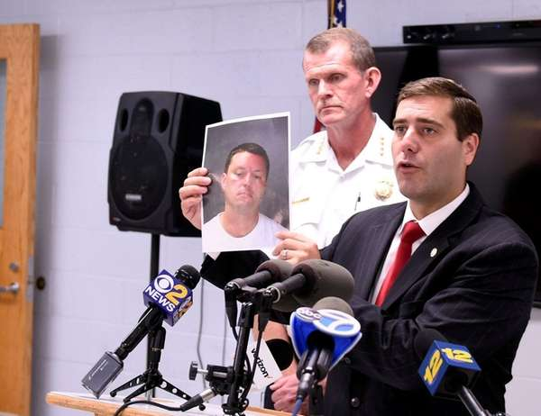 Suffolk County Police Commissioner Timothy Sini, with Police