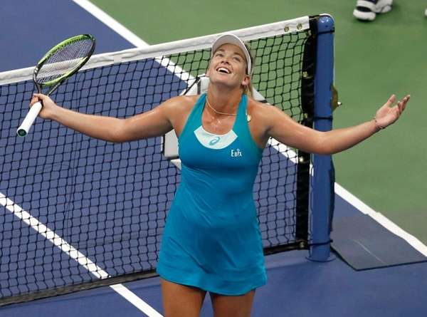 CoCo Vandeweghe celebrates after winning her match with Karolina