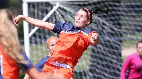 Manhasset's Olivia Wesch heads the ball on Sept.