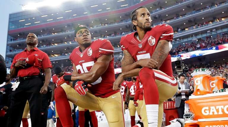 Then-San Francisco 49ers quarterback Colin Kaepernick, right, and