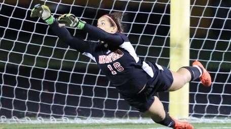 Newfield goalie Alexis Saladino makes a diving save