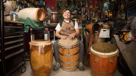 Drum maker and percussionist Joe Santiago plays a