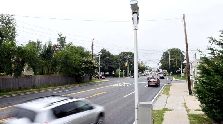A red light camera on Great East Neck
