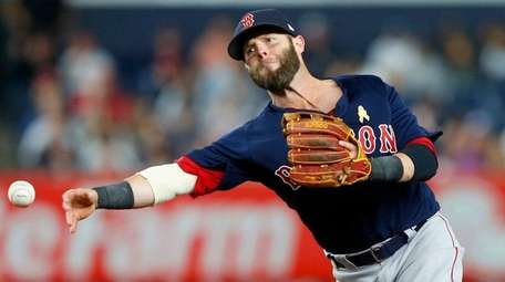 Dustin Pedroia of the Red Sox throws to