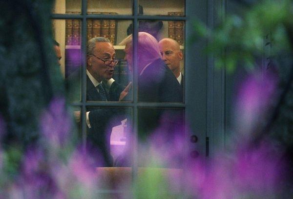 Senate Minority Leader Chuck Schumer talks with President