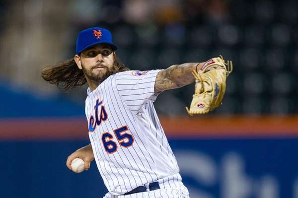 Mets pitcher Robert Gsellman delivers a pitch against