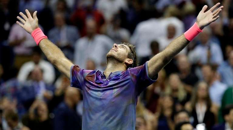 Juan Martin del Potro reacts after defeating Roger Federer during