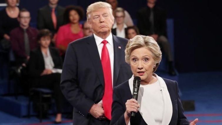 Republican presidential nominee Donald Trump, left, listens as