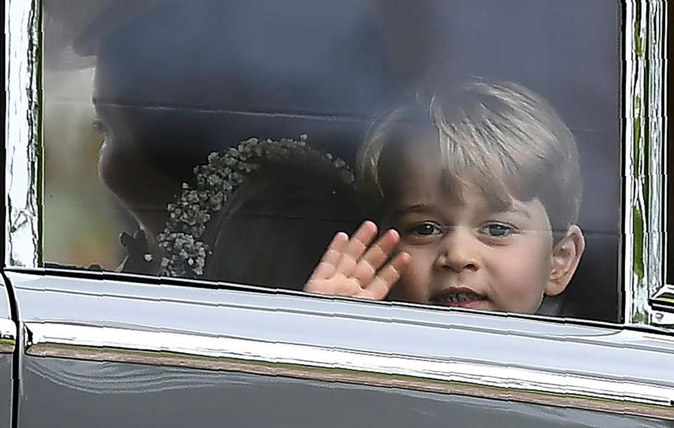Prince George waves as he leaves in a