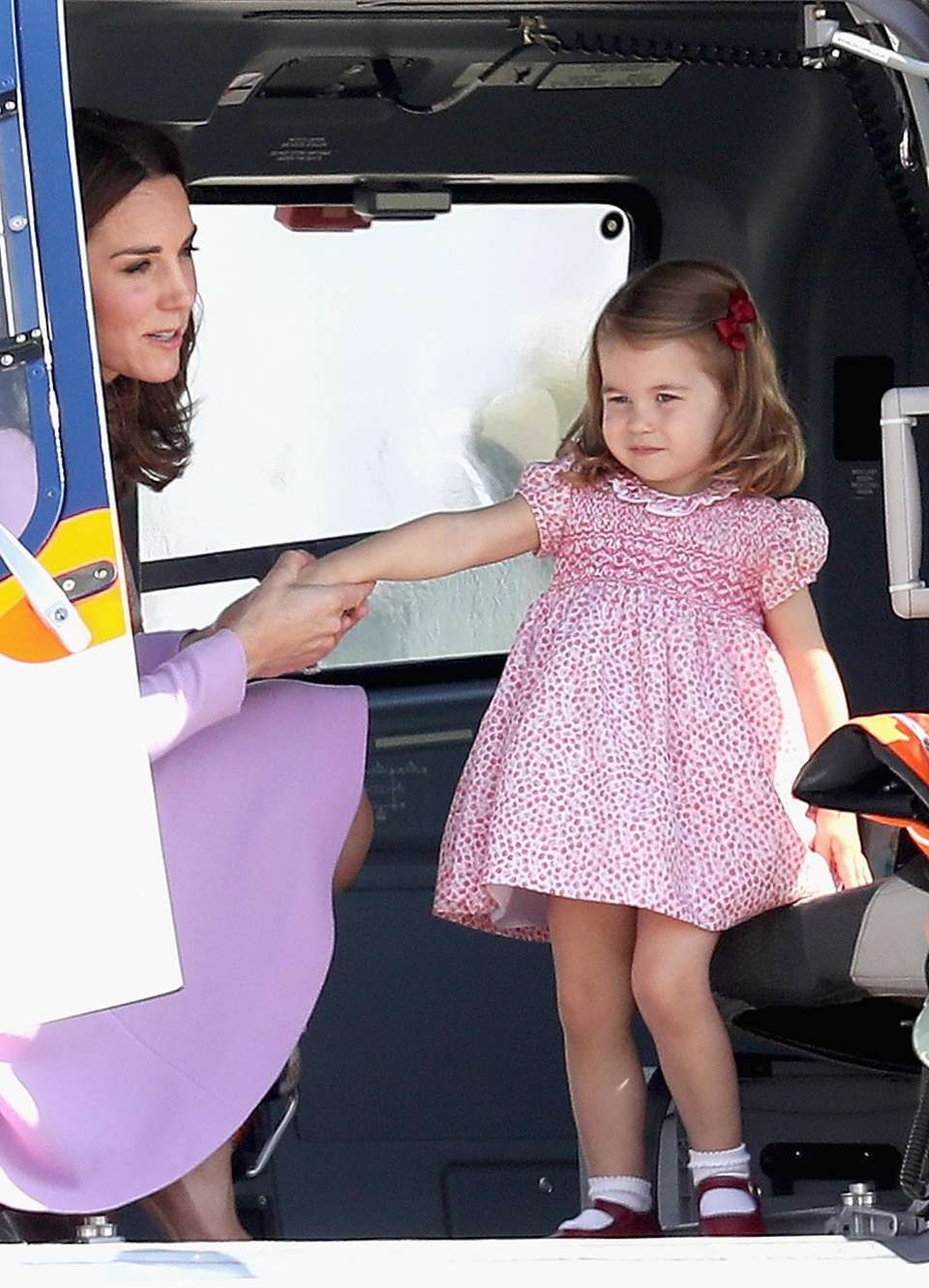 Princess Charlotte of Cambridge views helicopter models before