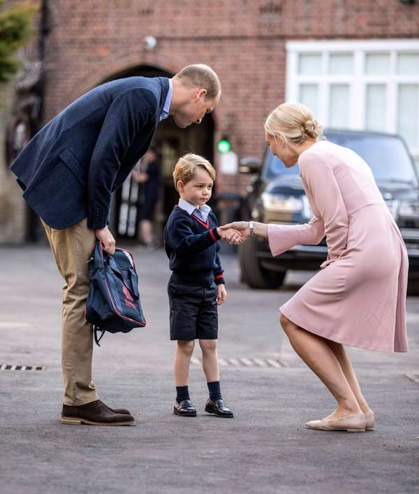 Prince George, accompanied by Prince William, meets with