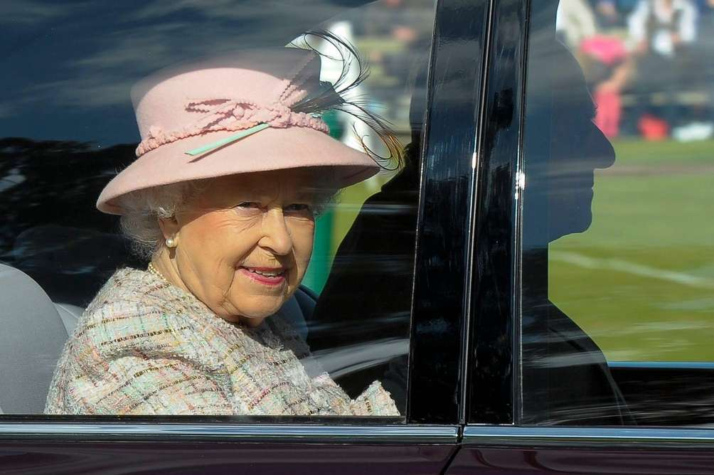 Queen Elizabeth II and Prince Philip leave the