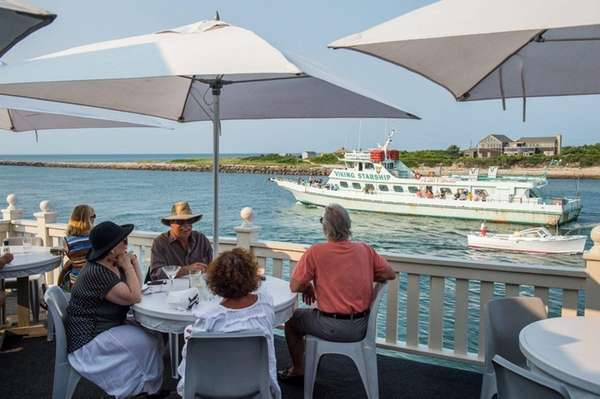 Diners overlook Montauk Inlet at Gosman's Dock in