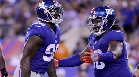 Giants defensive linemen Jason Pierre-Paul and Damon Harrison