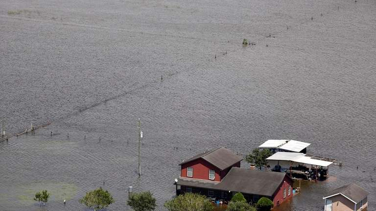 A house stands surrounded by floodwaters from Hurricane