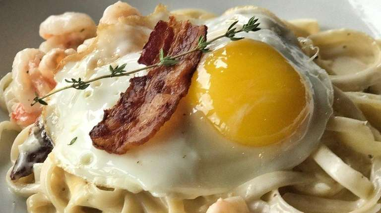 Shrimp carbonara fettuccine is served at The Tavern
