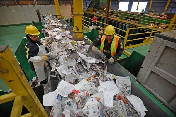 Workers at Green Stream Recycling perform quality control