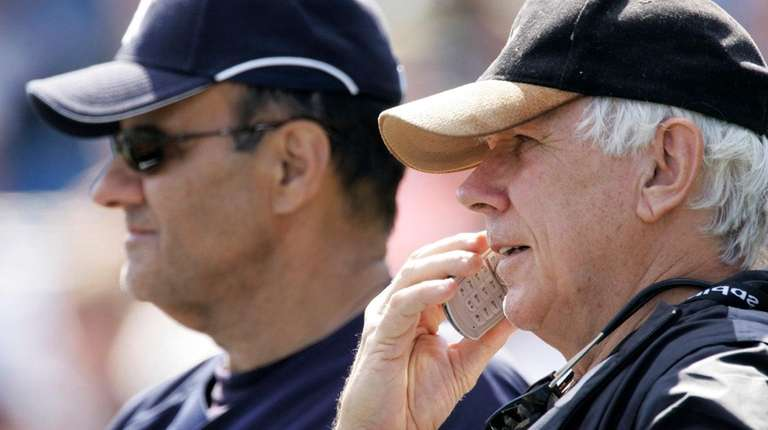 Yankees scout Gene Michael, right, watchesbatting practice with