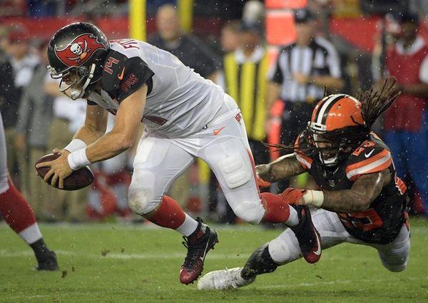 Buccaneers quarterback Ryan Fitzpatrick is sacked byBrowns' Calvin