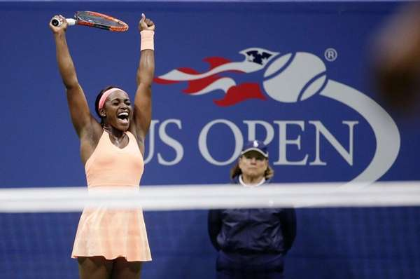 Sloane Stephens reacts after defeating Venus Williams during