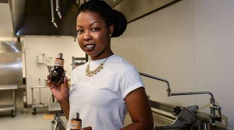 Alaila-Lee Lawrence produces a beverage, Sorrel, at the