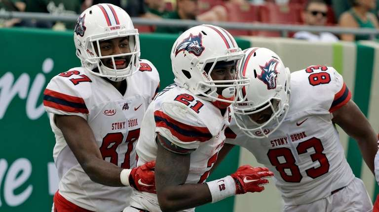 Stony Brook running back Stacey Bedell celebrates with