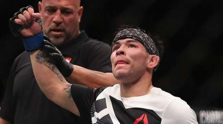 Ray Borg reacts to his victory over Louis