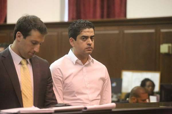 Hamlet Peralta, right, appears in Manhattan Criminal Court