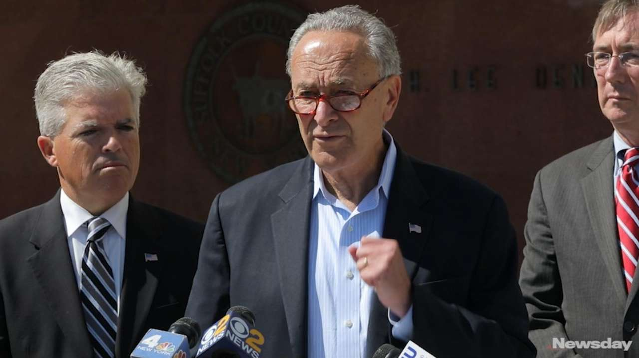 Sen. Chuck Schumer and other officials, at a